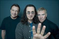 Rush - Geddy Lee, Neal Peart, and Alex Lifeson. One of the most innovative bands of modern music, yet never mentioned for induction into the Rock n Roll Hall of Fame... Hmmm...