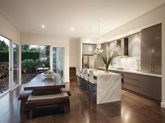 Casual dining room idea with wood panelling & bar/wine bar - Dining Room Photo 196638