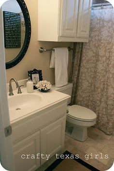 """This is EXACTLY like Jonathan's bathroom, except he still has the square mirror with """"glamour"""" type lighting like in the Before pic on this site. I'm loving the re-do mirror idea!"""