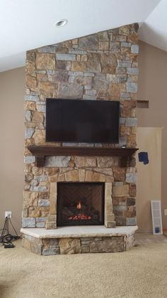 Mendota gas fireplace w/Slim Grace Front & Herringbone brick installed in Savage, MN. The stone is Mission River Blend natural stone with custom mantel and stone border, Indiana Limestone hearth. Build A Fireplace, Fireplace Hearth, Home Fireplace, Fireplace Remodel, Fireplace Inserts, Fireplace Design, Fireplace Ideas, Sandstone Fireplace, Concrete Fireplace