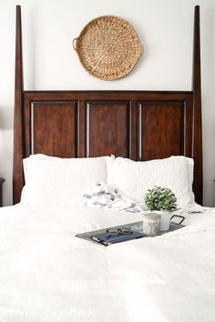 lovely, calming white master bedroom with natural wood tones and textures throughout | http://maisondepax.com