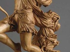 How to carve realistic wrinkles and folds on Woodcarving Illustrated website:    http://www.woodcarvingillustrated.com/techniques/carving-realistic-wrinkles-and-folds.html