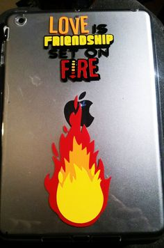 """Get your hands on this thought provoking rubber case for your ipad mini with this """"Love is Friendship Set on Fire"""" Jeremy Taylor vinyl decal already perfectly installed! This artwork is 100% original, you wont find it anywhere else. Decal wont come off and colors stay bright and brilliant much longer than printed plastic. This is a  great way to protect your ipad while keeping it unique.  Available Here…"""