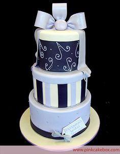 I think this is a real cake, but I'm thinking three hat boxes painted to look like a cake with goodies inside...