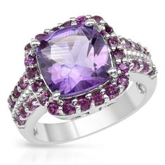 Sterling Silver Ring With Amethyst Size 8.  Majestic ring with genuine amethyst and rhodolite garnets well made in 925 sterling silver. Total item weight 6.8g. Gemstone info: 1 amethyst, 2.71ctw., cushion shape and purple color, 32 rhodolite garnets, 1.92ctw., round shape and reddish purple color.