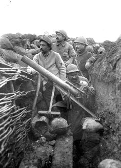 French troops in a trench using a pneumatic mortar, 1916. Pneumatic weapons like these were used throughout the French army before domestic industry could produce the required numbers of standard weapons. Once French industry had hit full war footing pneumatic weapons were generally replaced by mortars such as the 'Mortier de 58 mm type 2′.