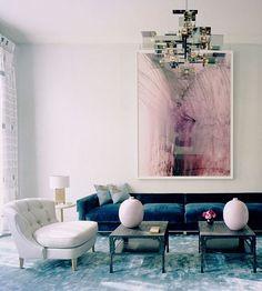Soft grey Living Room with blue velvet sofa, abstract art, blue rug.  Interior Designer: David Collins.