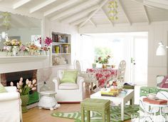 """""""My style of decorating is, 'I love this, I love that, let's put it all together and make it work,'"""" Ewart says. """"I'll mix polka dots and prints, all shades of green."""" In the living–dining area, a vintage coffee table and stools in Hable Construction's Sweet Pea Beads sit on a zebra-print rug by Jonathan Adler. The embroidered tablecloth, from Mexico, is available at Jacaranda Home."""