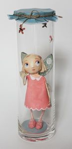 Cute fairy in a jar