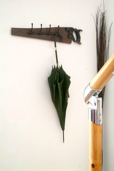 We found a new use for this old hand saw - it's now a coat hook