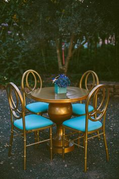 gold + turquoise seating // photo by Caroline Ghetes, styling by Events of Distinction // http://ruffledblog.com/colorful-sonoma-valley-wedding