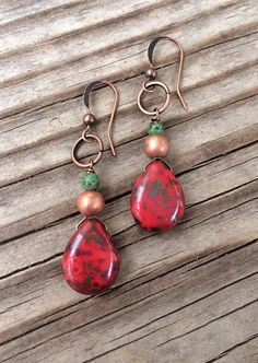 $26.00--Made with red Picasso Czech glass teardrops, copper and a bit of turquoise, these earrings will add a little splash of color! Approx 1.5 in length.