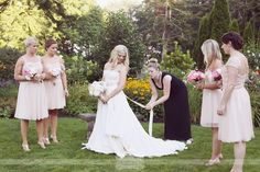 Love this candid shot of Andi helping the bride with her Lindee Daniel dress... Andi owns Andria Bird Bride, a bridal boutique in Newport, RI.  From a rustic outdoor wedding at the Glen Manor House in Portsmouth, RI.  #andriabirdbride #glenmanorhouse #lindeedaniel
