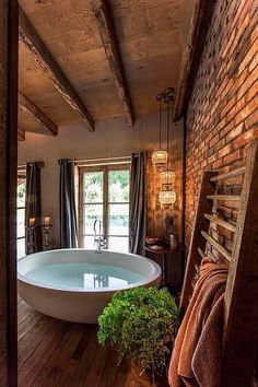 Some FABULOUS ideas for rustic bathrooms on this website   -   Barn Wood Flooring And Ceiling,  Exposed Brick Wall, Round Bathtub In A Great Rustic Bathroom