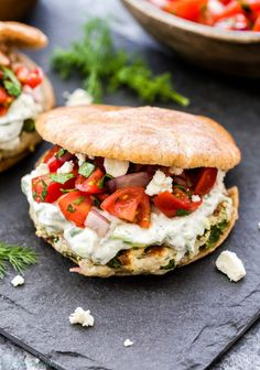 Greek Turkey Burgers with Tzatziki Sauce and Greek Tomato Salad- Juicy turkey burgers topped with cool, creamy tzatziki sauce, feta and a Greek tomato salad for maximum flavor. Serve them in pitas for a fresh and flavorful dinner!