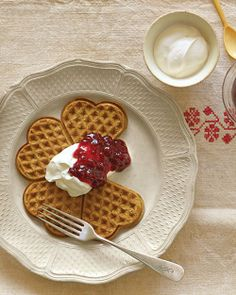Ginherbread Waffles - No ordinary breakfast, gingerbread waffles are an easy indulgence and best served with tangy sour cream and tart lingonberry preserves (although, truth be told, they're delicious with any type of berry jam). For a special touch, use a heart-shape waffle iron.