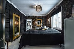 Black luxurious bedroom in a log house