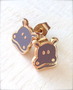 Donning my happy hippo earrings today... bought 'em at Mahina (my fave store in Kailua).