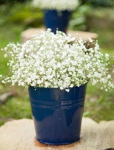 Extremely elegant and affordable navy and white table arrangements. This simple idea a bed of gypsophila on a blue bucket creates an elegant effect which is perfect for an industrial style wedding.