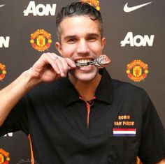 Robin van Persie, playing darts.