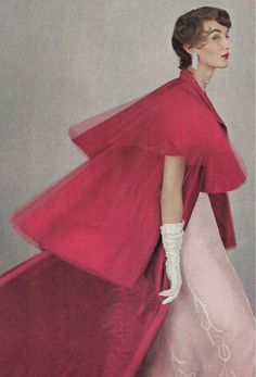 Evelyn Tripp wearing gown and coat by Mainbocher and diamonds by Harry Winston, Vogue 1953