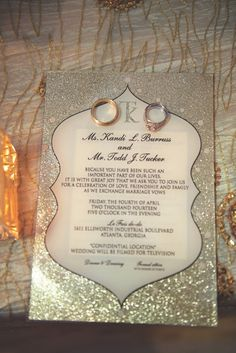 The Real Housewives of Atlanta's Kandi Burruss and her husband Todd Tucker's wedding invitation featured a silver glitter design and monogram. #weddingstationery #weddinginvitation Photography: Robin Gaucher Photography. Read More: http://www.insideweddings.com/weddings/kandi-burruss-and-todd-tucker/560/