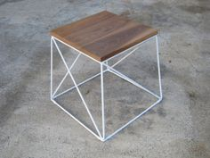 Walnut side table with white powder coated steel base. Use as a bedside table.