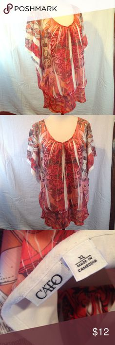 XL Cato 👚blouse This extra-large Cato shirt is in excellent used condition. Fades from orange to pink to red. Perfect for work or a day out. Elastic on bottom for a better fit. Please see photos. Please ask any questions before purchasing. Cato Tops Blouses