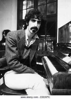 Musician Frank Zappa seated at a piano - Stock Image