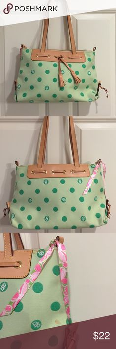Dooney & Burke Purse Green polka dot purse. Overall in good condition. There is a small stain though and I lost the tab to pull the zipper so I improvised with some Lilly Pulitzer ribbon. It's long enough to wear as a shoulder bag. Dooney & Bourke Bags Shoulder Bags