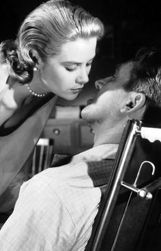 Grace Kelly and Jimmy Stewart in Rear Window (Hitchcock, 1954)
