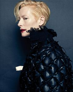 Tilda wears quilted jacket with high collar from Chanel