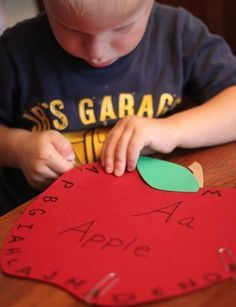 Fine motor practice with paper clips while learning letters by bernadette