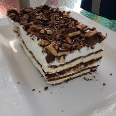 Heath candy bar icecream sandwich cake....cool whip, fudge, caramel, and toffee chips in between layers. Delish!!
