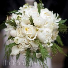 {A Lovely Winter Bouquet Which Includes: White Peonies, White Roses, White Ranunculus, White Mini Callas, White Stock & Evergreen}