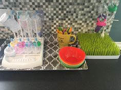 Baby bottle and utensil organization. Munchkin brand drying rack and Boon grass drying rack from Target.