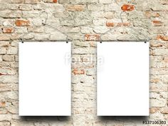 Two blank frames hanged by clothes hanger against weathered brick wall background