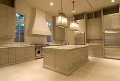Kitchen with italian marble counters, french stone floors and antique fixtures