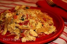 Tex Mex Migas - Eggs, scrambled with hot peppers and tomatoes, and tossed with crispy fried tortilla strips, makes for a fine meal whether it be breakfast, lunch, or even breakfast for dinner.