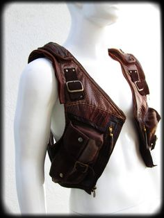 Modular Mens leather vest in brown. Full vest with detaching hood zips apart into a shoulder hoster. Separates into 8 pieces. Custom order design by Ahni Radvanyi for Resonating Threads Shop. Leather Armor, Leather Holster, Leather Vest, Leather Jackets, Pink Leather, Steampunk Accessoires, Mode Steampunk, Sacoche Holster, Leather Projects