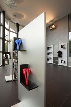 #totem and #magnetic #shelves at Pinarello Store. Ronda Design