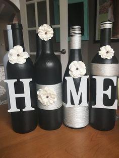 HOME WINE BOTTLE decor, home wine bottles, home decor, hand made wine bottle decor, black and white wine bottles, black and white, display