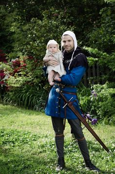 My friend, Ian, and lovely daughter.  Dad is portraying a late 1300's early 1400's nobleman.  Awesome kit.