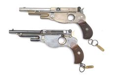 Schmeisser-Bergmann M1893 prototype pistols Designed by Otto Brauwetter and Louis Schmeisser c.1892 and manufactured by Bergmanns Industriewerke GmbH in 1893.7,5mm Swiss revolver cartridge, five-round en-bloc clip loaded through a sliding side-plate, delayed blowback semi-automatic
