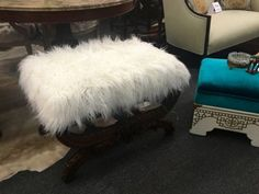 Intricately Carved Bench With Cream White Fur Upholstery   $675  Grace Designs at Forestwood Dealer #333  Forestwood Antique Mall 5333 Forest Lane Dallas, TX 75244  Antique and vintage furn