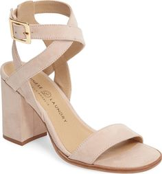 A trend-right chunky covered heel elevates this wear-with-everything sandal in supple kid suede, styled with a wraparound ankle strap.