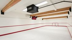 Indoor Hockey Rink. Bear Mountain Custom Home. When a hockey-loving Langford family has the urge to play, they just head to their in-home 56-foot-by-24-foot synthetic ice rink. They can go downstairs with a full locker-room and tv screen so they don't miss their shows while they play hockey. Hockey Decor, Hockey Room, Backyard Hockey Rink, Synthetic Ice Rink, Inline Hockey, Hockey Pictures, Hockey Training, Hockey Season, Bear Mountain