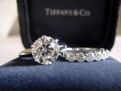 Tiffany & Co. engagement and wedding ring  now, customize it to what i want.. change the round to princess cut with diamonds around the outside, square band and princess cut on the wedding day band :D  if i marry rich, this is what i want lol not likely, but a girl can dream!