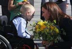 Duchess Catherine receiving flowers from Riley Oldford.