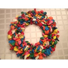 Balloon wreath!  Great for a Sesame Street themed birthday party. Original idea on my Party Ideas board.
